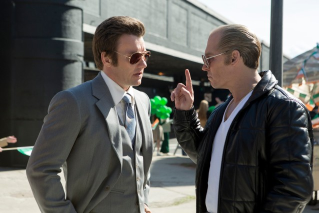 """In this image released by Warner Bros. Entertainment, Joel Edgerton portrays John Connolly, left, and Johnny Depp portrays Whitey Bulger in the Boston-set film, """"Black Mass."""" (Claire Folger/Warner Bros. Entertainment via AP)"""